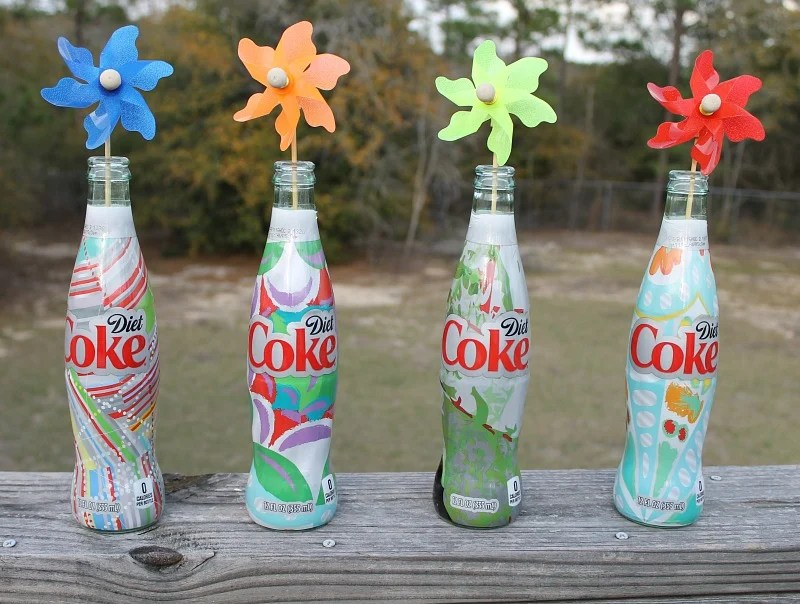Garden Party Decorations Easy Upcycle project with Diet Coke It's Mine bottes, sand and pinwheeles.intelligentdomestications.com