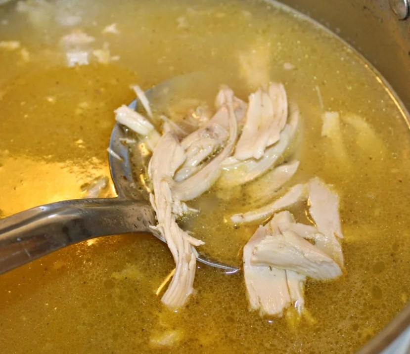 boiled chicken in a pot with broth