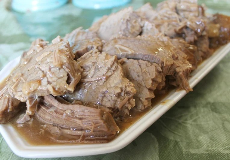 Cook Once Eat Twice when you make this tender juicy Sunday Dinner Oven Roasted Beef. Serve it with veggies one day and make sandwiches with the leftovers the next day