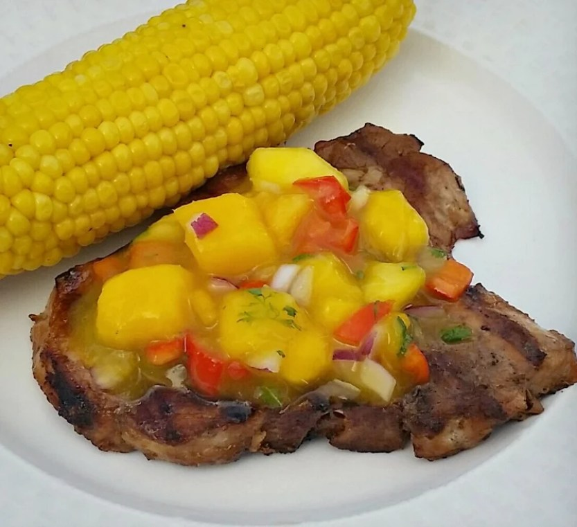 grilled pork chop with peach mango salsa
