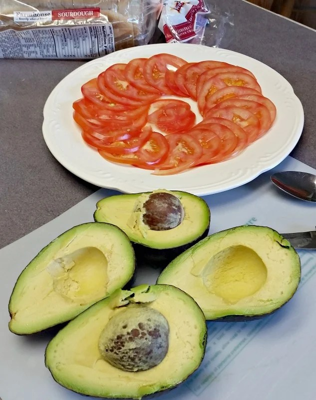 Prep some Avocado and Tomatoes to make Waffle Iron Grilled Avocado Tomato Sandwiches
