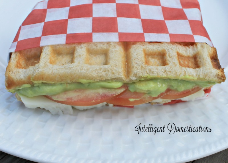 Serve your Waffle Iron Grilled Avocado Tomato Mozerella Sandwiches wrapped in pretty paper