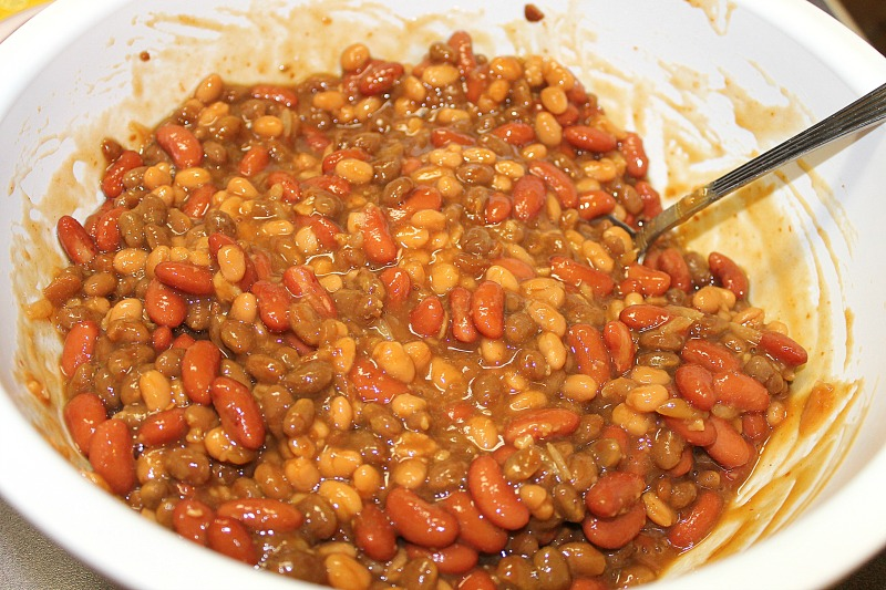 I mix all of my bean ingredients in a bowl before pouring into the baking pan or Bean pot