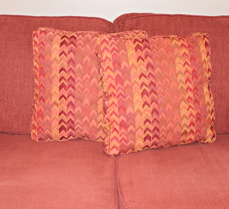 Sofa pillows before their new pocket covers
