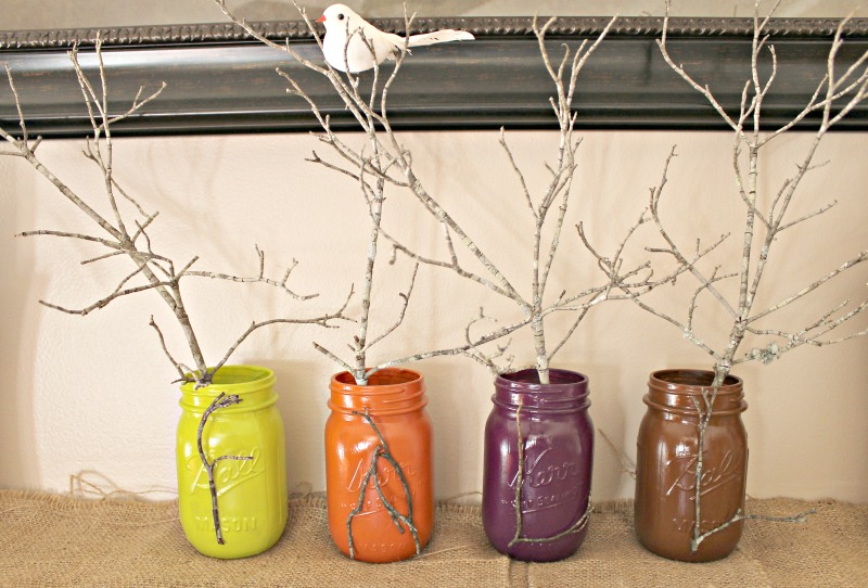 painted-fall-color-mason-jars-decorated-with-dogwood-sticks-to-spell-fall-and-a-white-dove-sitting-in-the-leafless-branch-intelligentdomestications-com