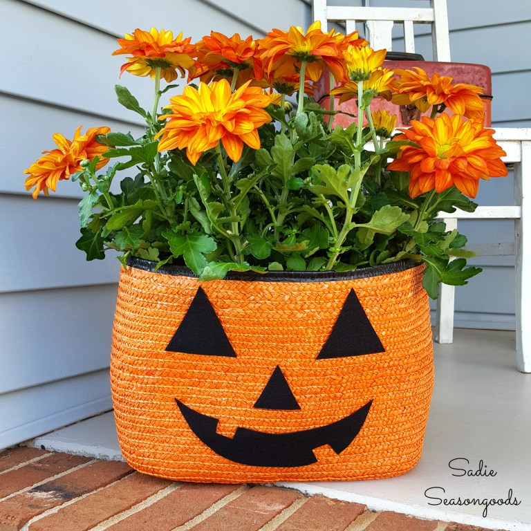 7_orange_black_straw_tote_bag_to_be_repurposed_as_halloween_pumpkin_jack_o-lantern_porch_planter_for_pele_mums_by_sadie_seasongoods