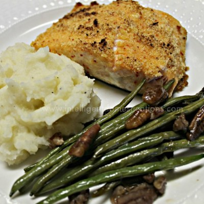 Make this yummy recipe for Parmesan crusted Salmon. It makes a delicious weeknight meal or special occasion meal. We make ours in the iron skillet and serve restaurant quality side dishes. #salmonrecipe #weeknightmeal #ironskilletrecipe