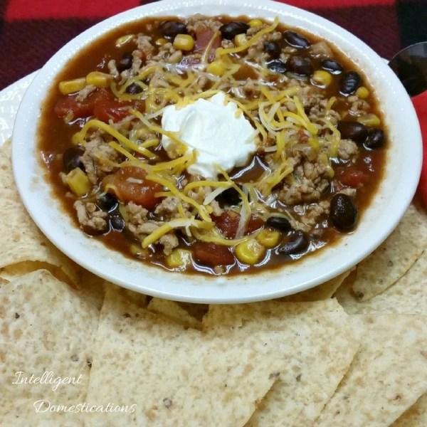 Black bean Taco soup in a white bowl