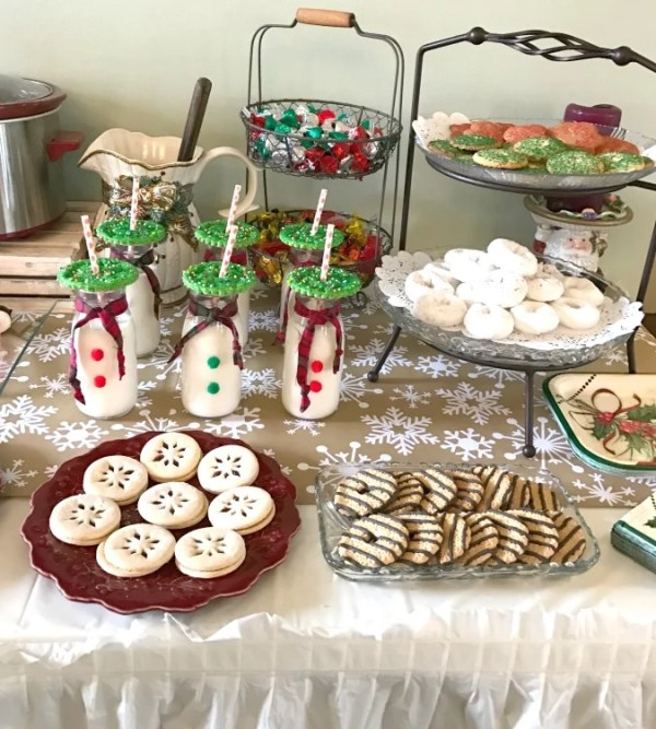 Cookies and Cocoa Theme Christmas Party. Cookie party. Christmas party cookie buffet. How to style milk jars for a party