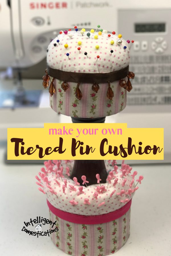 Use some scrap fabric and a couple of cans to make a Two Tier Sewing Pin Cushion for your sewing room or craft room. A nice upcycle project for the craft room. Easy tutorial. #craftroom #sewingroom #repurpose #upcycle #intellid #craftroomstorage