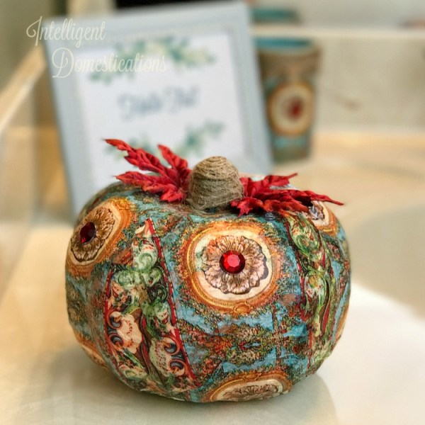 How to decoupage a pretty napkin onto a dollar store pumpkin. Dollar Store pumpkin makeover. Decoupage pumpkin. DIY Pumpkin craft idea.