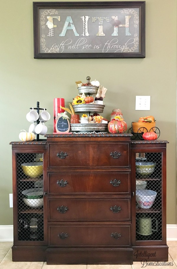 An antique dining room sideboard decorated with a Fall coffee bar