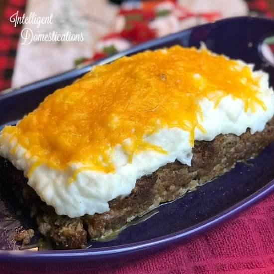 Cheesy Mashed Potato Smothered Meatloaf.. How to make cheesy mashed potato topped meatloaf. A Christmas Story Mashed Potato Meatloaf recipe. #meatloaf #recipe #weeknightdinner #groundbeefrecipe