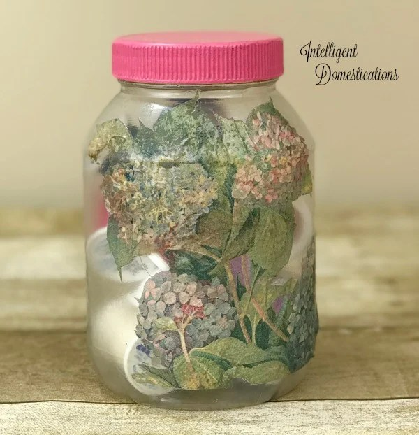 Decoupage a pretty paper napkin onto a mayonnaise jar to create craft room storage containers