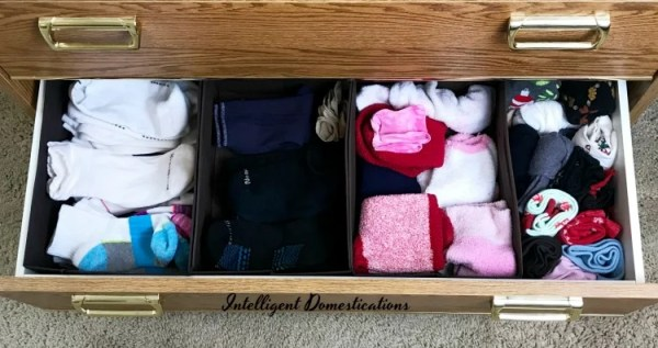 Simple Sock Drawer Organization. How I organized my sock drawer without a lot of work. Uses for collapsible bins in drawer organization. Before and After Sock Drawer Organization. After photo of sock drawer organization