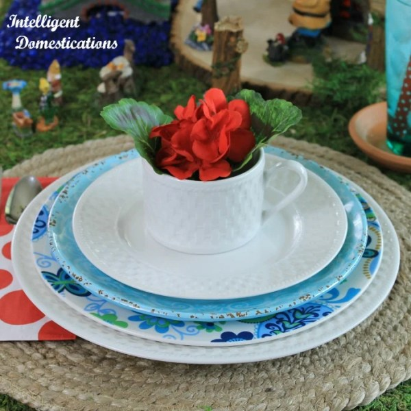 Blue and white stacked dishes. Place setting for a Fairy Garden Tablescape. #fairygardentablescape