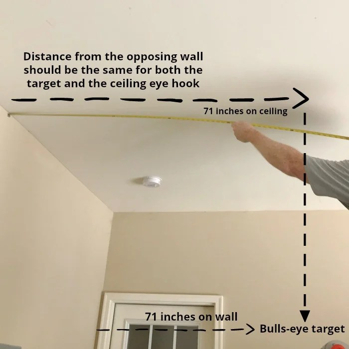How To Install A Ring and Hook Garage Game.How to measure the distance on the ceiling for the eye hook ring.