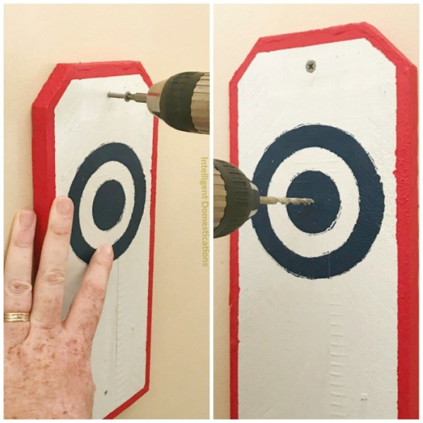 "How to install a Ring and Hook game in your garage. Use Two 2"" deck screws to attach the bulls-eye board to the wall"