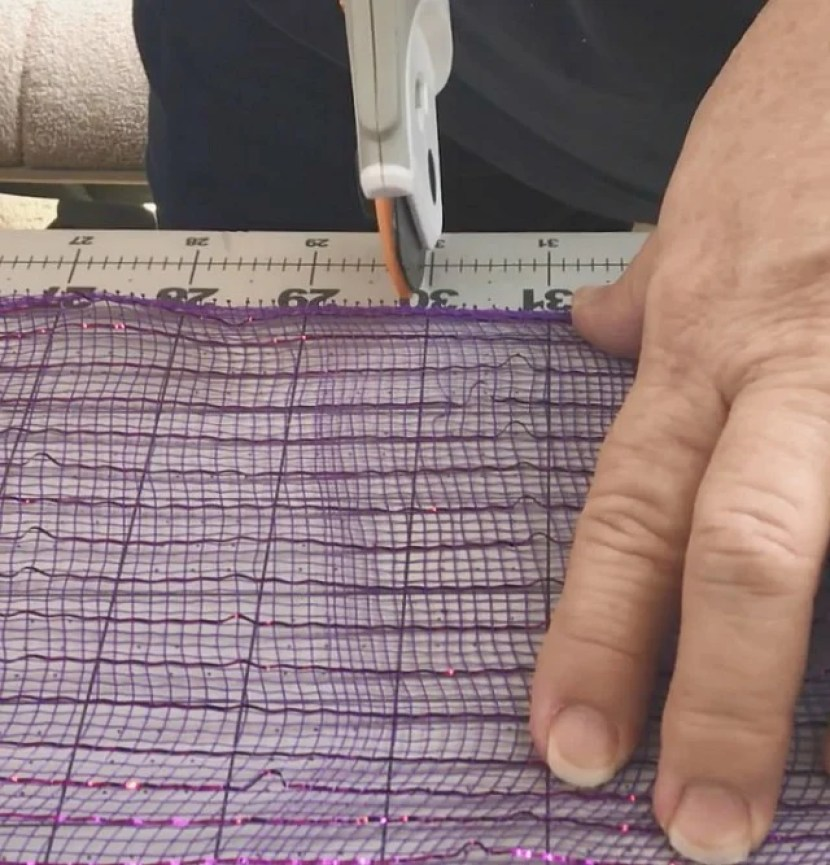 a rotary cutter and purple Deco mesh