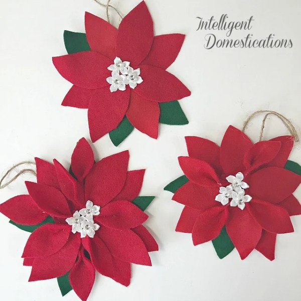 How To Make A Felt Poinsettia Ornament for your Christmas tree. These are super easy and affordable making them a perfect gift to give or keep them for yourself. #poinsettia #DIYornament #Feltcraft