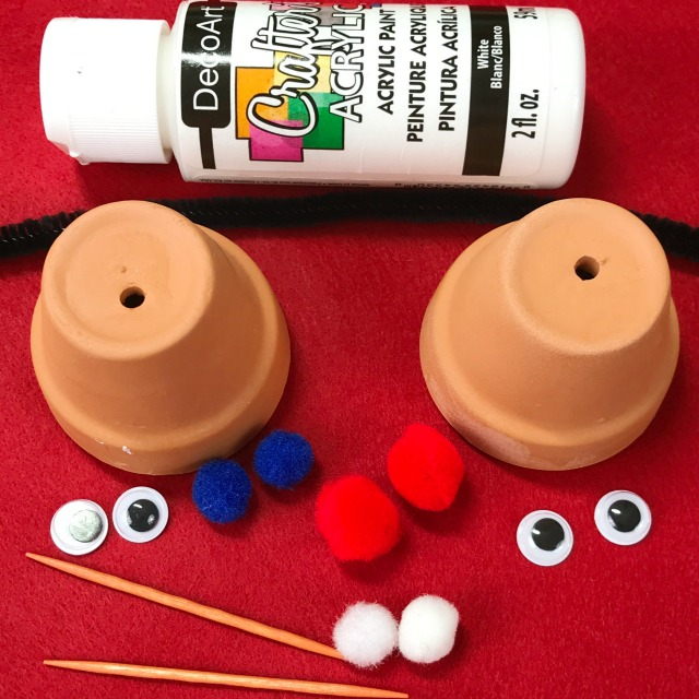 clay pots and googly eyes and other craft supplies