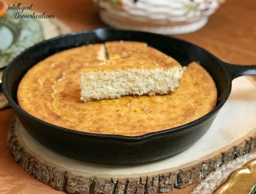 Cornbread cooked and served in an iron skillet