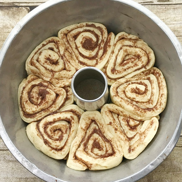 Raw cinnamon rolls placed into the bottom of a Tube Pan for baking