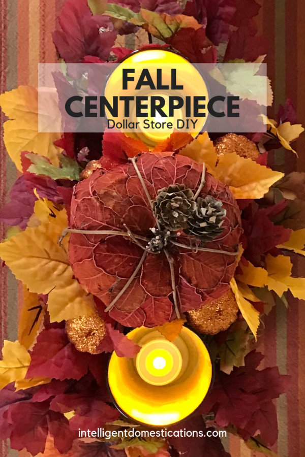 Make your own rectangular Fall Centerpiece using our tutorial. We used mostly Dollar store supplies with a couple of repurposed items. We spent less than $15 on the whole table centerpiece. #fallcenterpiece #DIYCenterpiece