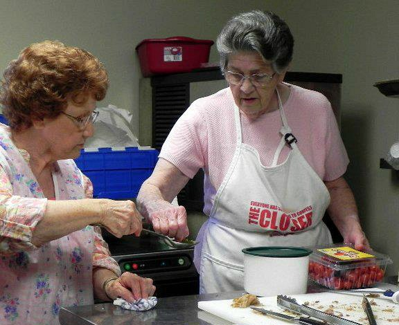 Momma and Jo cooking a meal in the kitchen at church for a Ladies event.