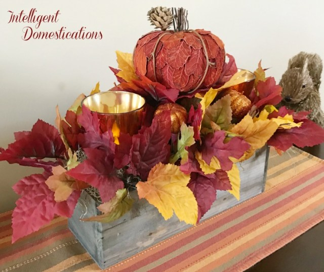 This Rustic Fall Centerpiece is an easy DIY project using mostly Dollar Tree supplies. You can create your own Fall table decor with our easy to follow tutorial. This Fall Floral arrangement is crafted in a rectangular wood box. You can use any rectangular container you have on hand. #Fallcenterpiece #Falltabledecor #Falldecor