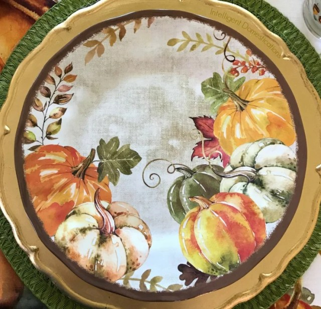 Fall Table decor ideas using everyday dishes and elements from nature. Pine cones make a nice centerpiece for a Fall Tablescape. Melamine dishes and a clearance Tablecloth bring it all together. #tabledecor