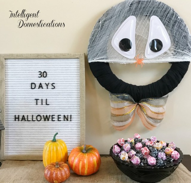 You can make this Silly Spider Web Halloween Wreath in minutes using Dollar store supplies. He is afraid of spiders which is funny since he's a spider web! #HalloweenWreath