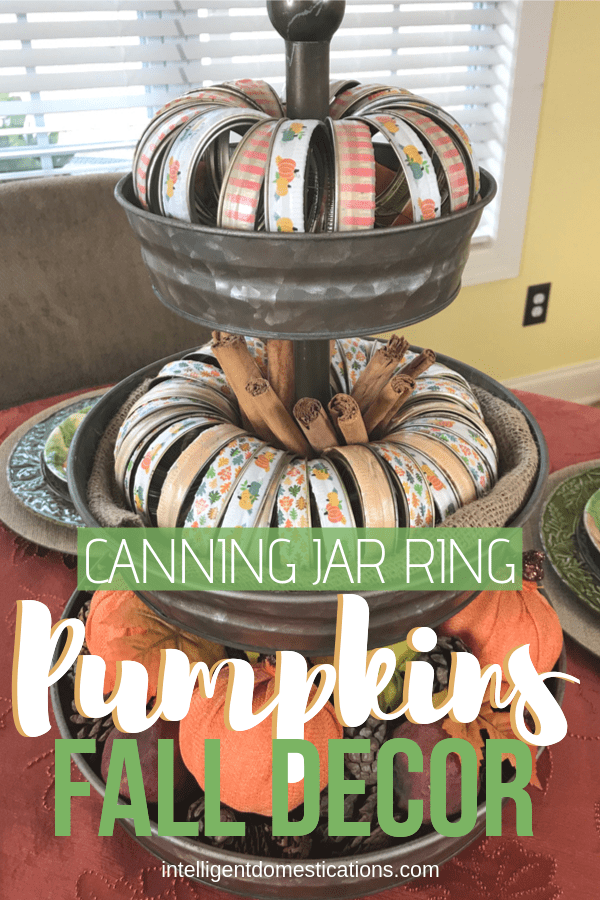 Make these cheap and easy Canning Jar Ring Pumpkins using Mason jar lid rings and Washi Tape. Style them onto your Three Tier Tray for a pretty Fall Centerpiece.