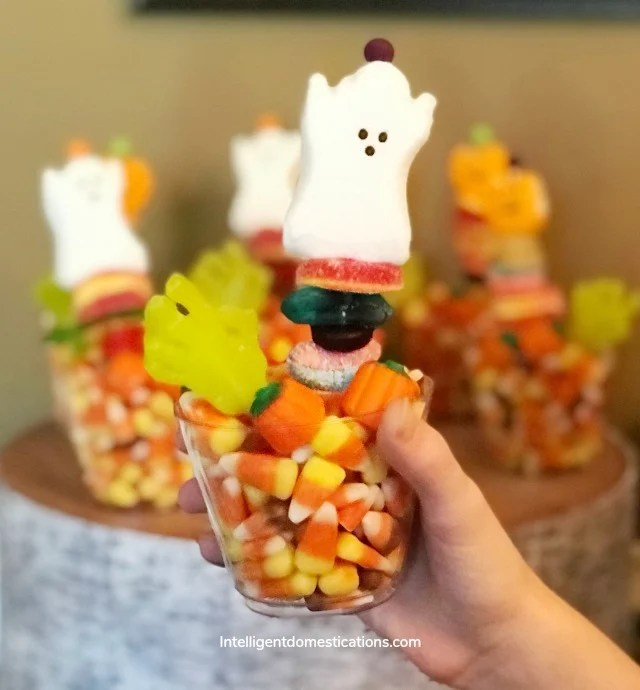 Halloween party favors Candy Kabobs stuck in a clean cup full of candy corn