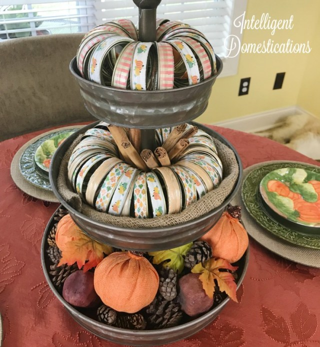Make your own Mason jar ring pumpkins decorated with pretty Fall Washi Tape. I used mine to style a 3 tier metal stand for Fall decor.