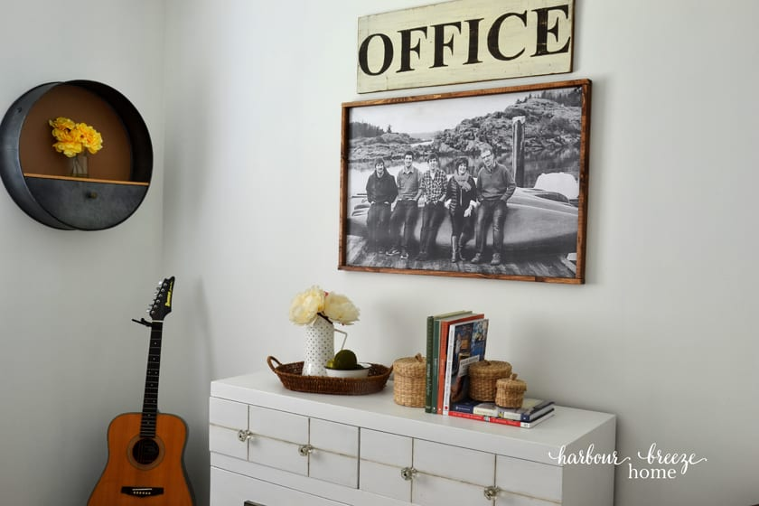 Home decor displayed on a piece of furniture and on the wall behind it