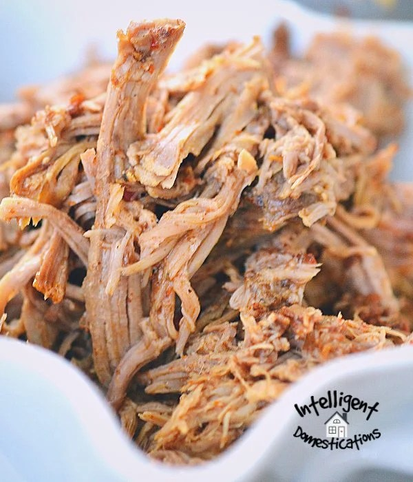 This Crock pot pulled pork for BBQ recipe is super easy with only a few ingredients. Put it in the slow cooker and forget it for hours.This is a must have easy recipe to feed a crowd when you are entertaining. #bbqpork #slowcookerpork #porkbutt #partyfood