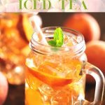 Iced tea served in a Mason jar glass with a handle with ice and peach slices