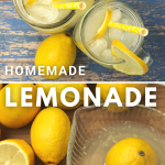 Lemonade in a glass and lemons next to a glass fruit juicer
