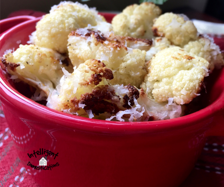 Roasted cauliflower with parmesan cheese in a red bowl