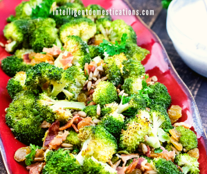 Broccoli Salad with bacon served in a big red dish