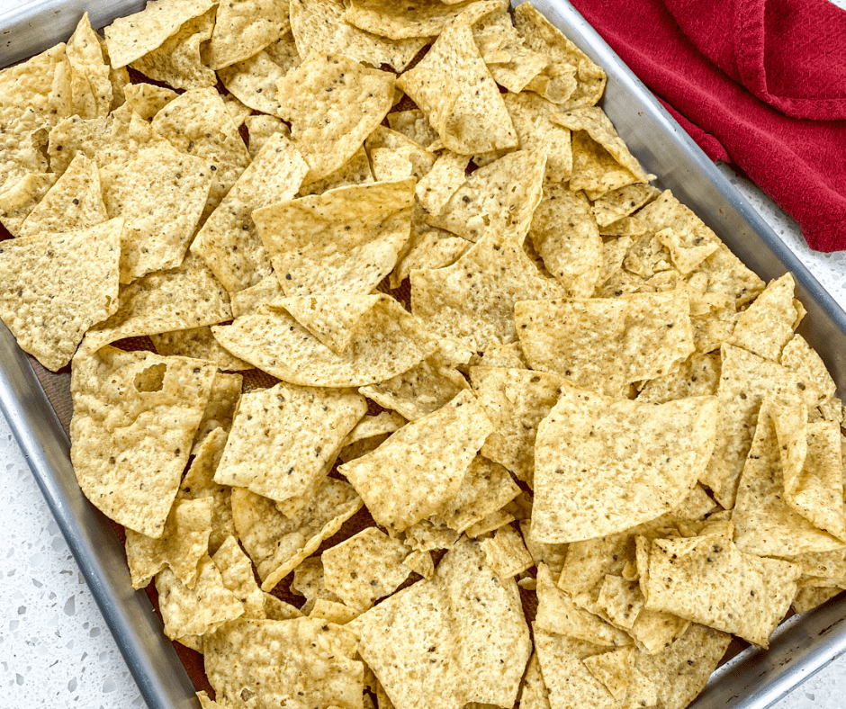 Nacho chips spread onto a sheet pan