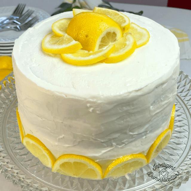 lemon layer cake decorated with cut lemons