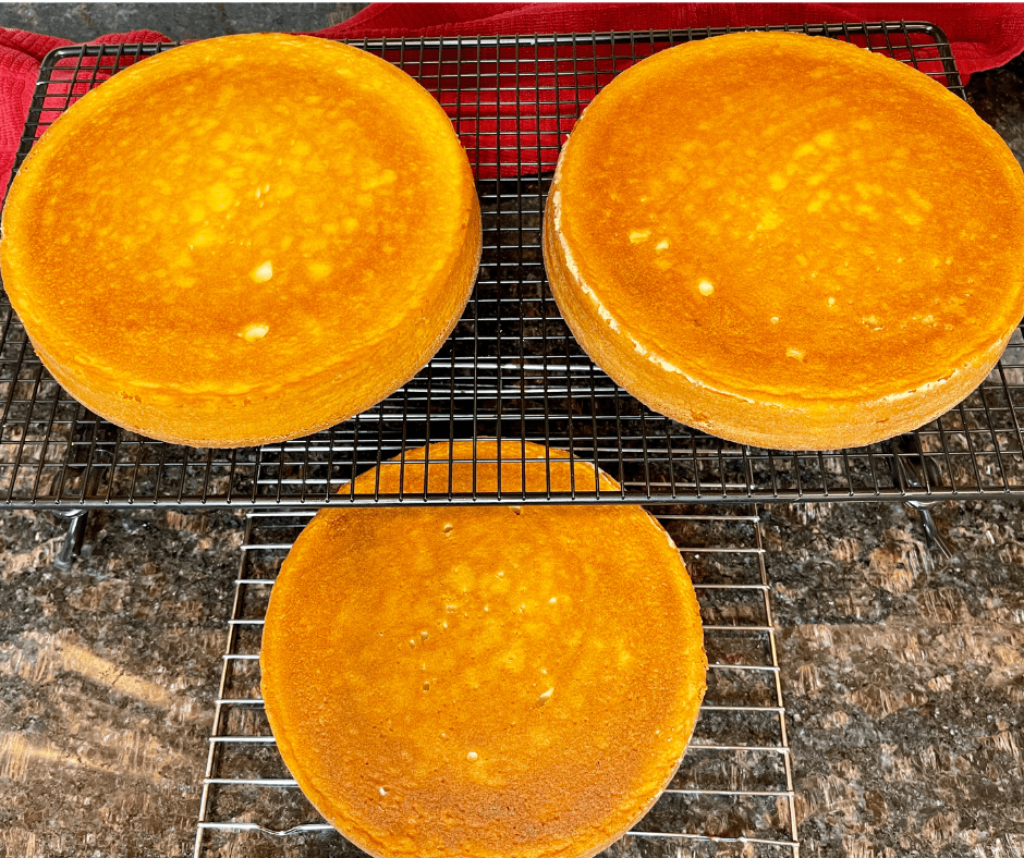 round cakes cooling on wire racks