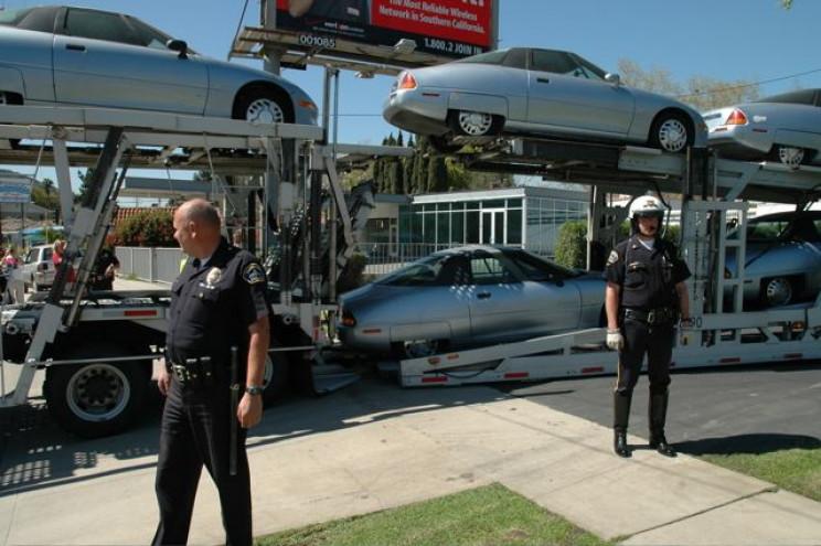 Police escorting EV-1s