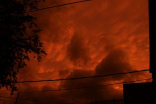 Gnarly Storm Forming Over Saint Paul at Sunset - by AndoR