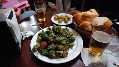 image of a plates of tapas; olives, bread