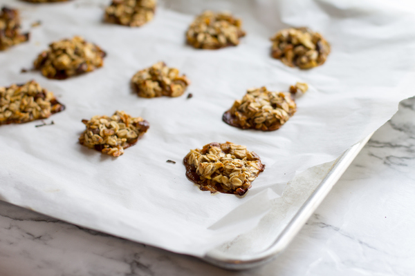 image of Irresistible apple pie protein cookies by intentionally eat with cindy newland on parchment paper on a cookie sheet