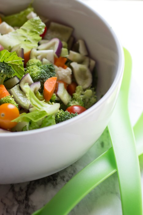 image of Garden Salad That Lasts All Week by Intentionally Eat with Cindy Newland in a white bowl with green spoons