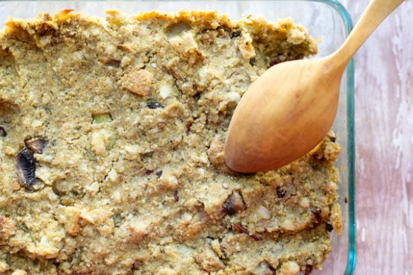 image of the tastiest vegan stuffing by intentionally eat with cindy newland in a glass dish with a wooden spoon